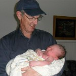 Grandpa holding Felicity for the first time.