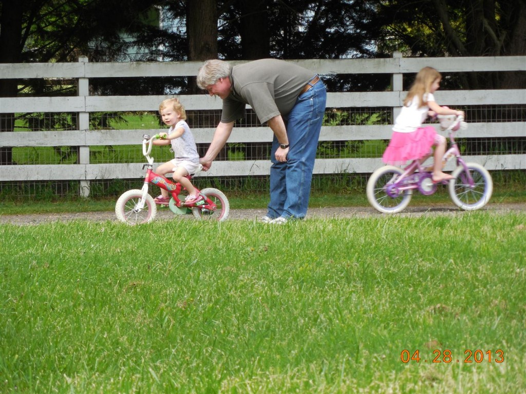The grandpas took turns helping Maggie ride her bike... Anna went up and down, showing us how fast she is!
