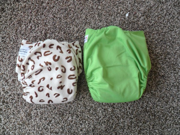 "Comparison of typical one-size diaper and ""big baby diaper""  This is an assuntastore diaper, which is just barely bigger than a BumGenius one-size."