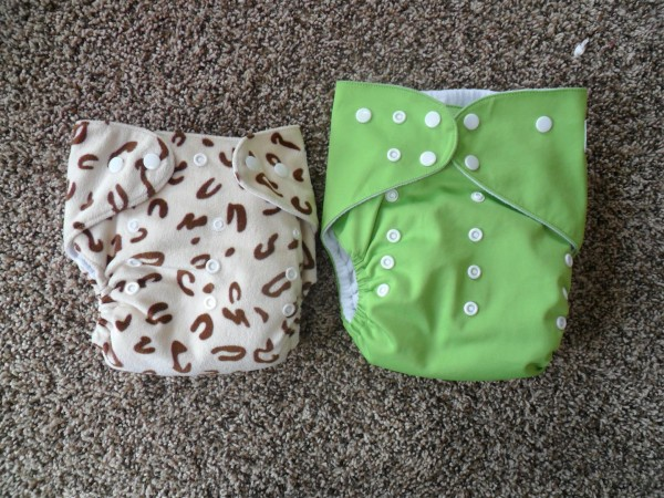 The front of a typical one-size pocket diaper and the Alva Big Baby diaper.