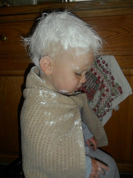 She smeared GOBS of Vaseline in her hair.  I could not get it out.  Finally, I rubbed corn starch into her vaseline slick and it soaked it up.  She left corn starch smears all over the house, but it was better than straight petroleum jelly smears.  Oh dear... some days.