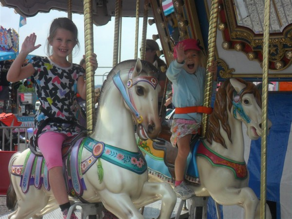 Definitely never too old for a merry go round!  My pretty girls.