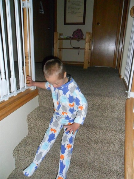 Jordan woke up just as the girls finished their stockings! He loves to slide down the stairs this way.