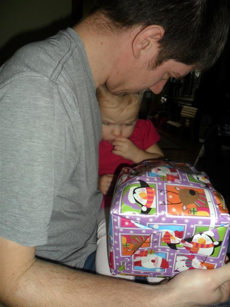 Mid gift-opening, Carolyn got sleepy and shy and snuggly and curled up in Brian's arms.