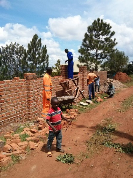 The wall around the clinic compound getting built...
