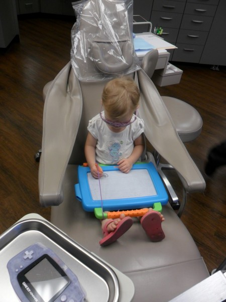 Time for the kids to get their teeth cleaned! This is the first time Carolyn has been in the chair.