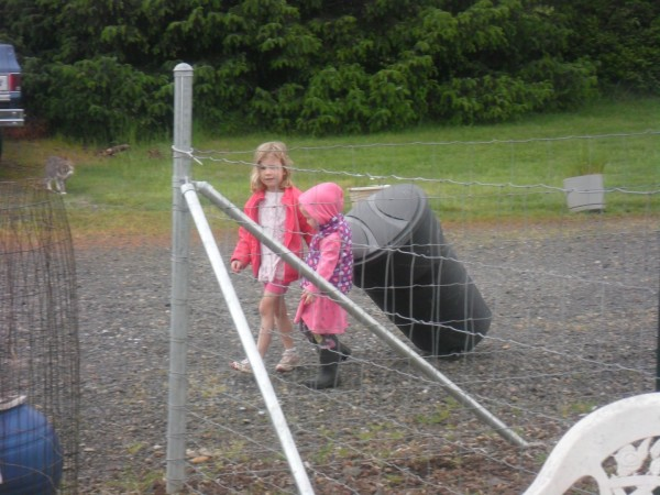 Soooooo cute - Maggie and Carolyn bringing in the empty garbage can together.