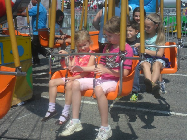 Here are Anna and Maggie getting onto a swing ride that swings them in a slow circle.