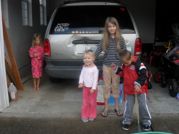 "This is what I got for a ""first day of school"" picture. Anna (3rd grade), Maggie (K/1st grade) Jordan (1st grade), Carolyn (3's preK)"