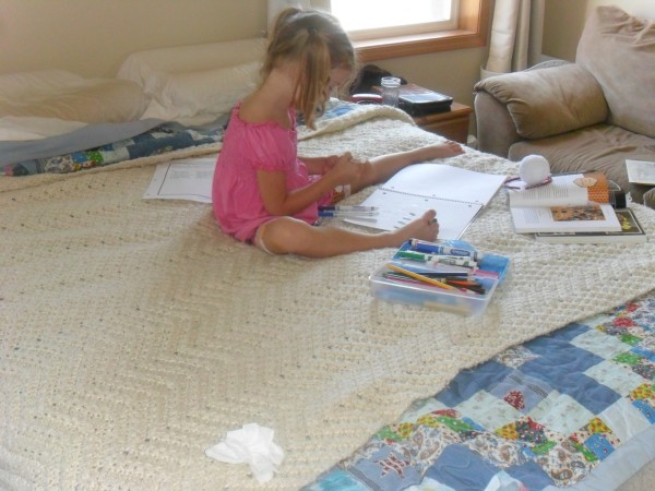 Maggie working on her Beekeeping journal.