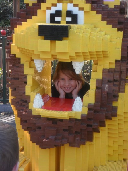 "All the kids were going to pose in the Lego lion until a sensor ""saw"" them and it roared. Then Anna plugged her ears and went in for a very short smile. haha"