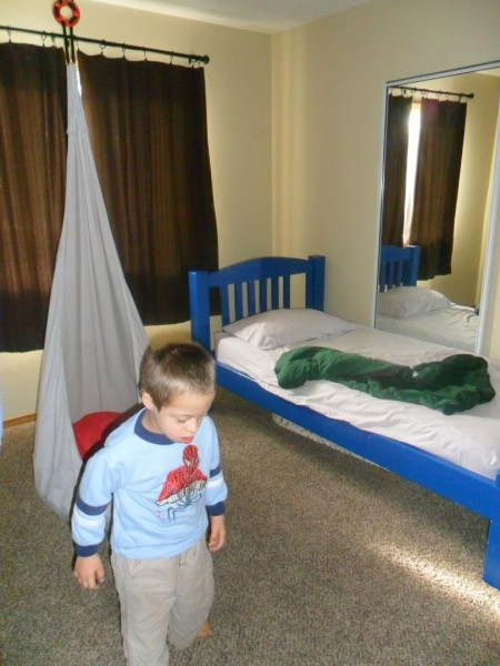 Jordan's bedroom... perfect for him. Swing (that he falls asleep in two out of three nights and we carry him to bed) his bed with a weighted blanket (that he throws on the floor anyway) and a heated mattress pad... a mirror and light-blockign windows. He has a lock on his light switch.