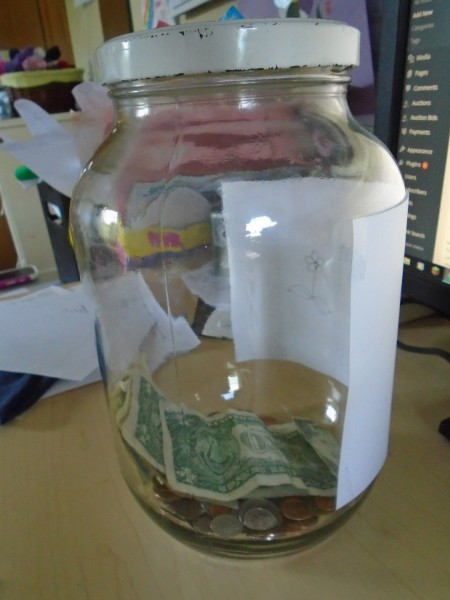 This is our orphan care savings jar! There is about $15 in there already!