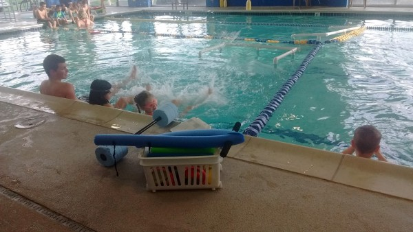 Maggie in her swimming lessons! She swam without a floatie in deep water for the first time in this class. She can swim without help from one place to another, so long as they aren't too far apart.