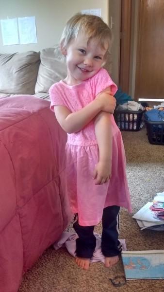 Grandma gave Carolyn a new dress. Awwwwwww.
