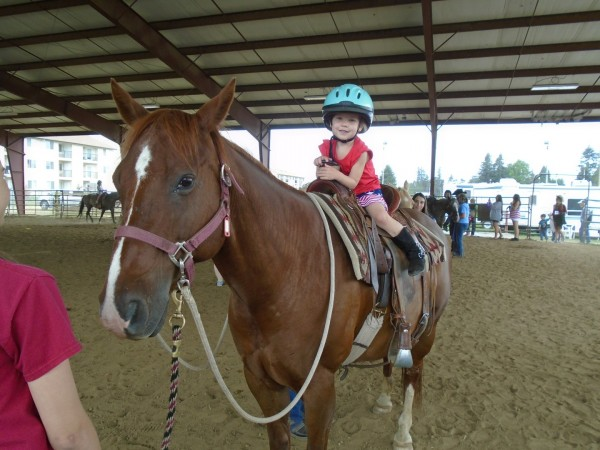 The rodeo had free pony rides! Look at my big girl!