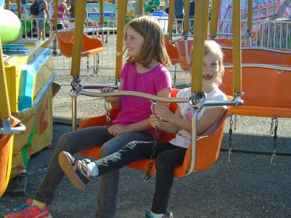 Anna and Maggie went on the mid-sized swing ride.